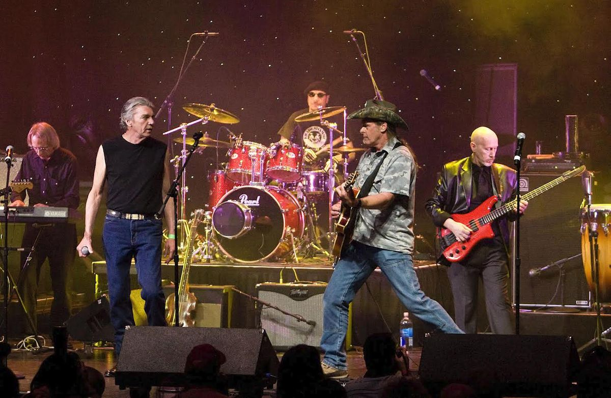 John Drake (left foreground in sleeveless shirt) reunited with members of the Amboy Dukes — including Ted Nugent (center, in the cowboy hat) at the 2009 Detroit Music Awards.