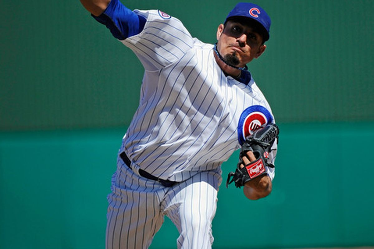 Matt Garza of the Chicago Cubs throws a pitch against the Kansas City Royals during a spring training baseball game at HoHoKam Stadium in Mesa, Arizona.  (Photo by Kevork Djansezian/Getty Images)