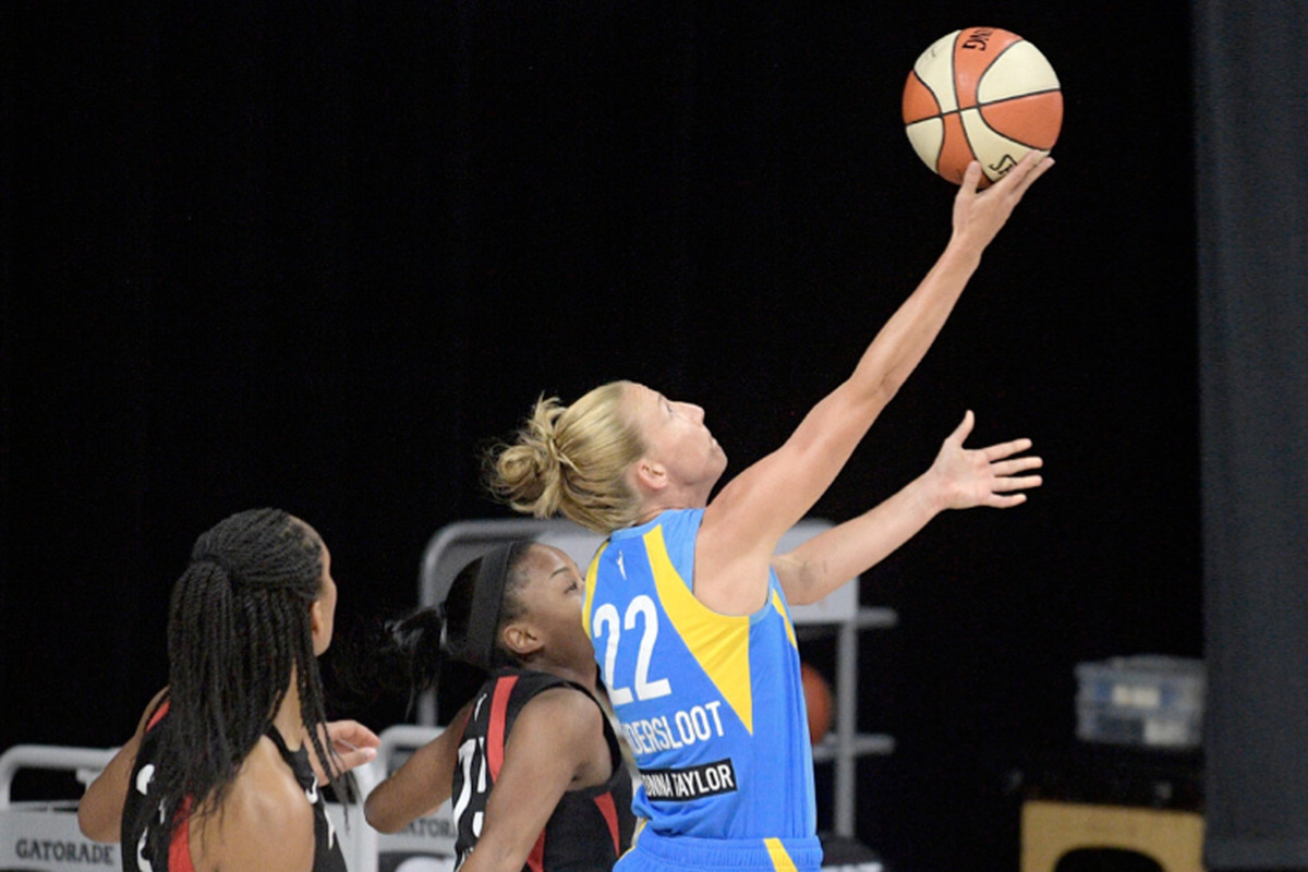 Sky guard Courtney Vandersloot (22) goes up for a shot in front of Las Vegas Aces center A'ja Wilson (left) and guard Lindsay Allen during the first half Tuesday in Bradenton, Fla.