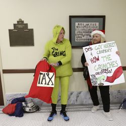 Greg Zenger and Janalee Tobias wait in the hall after being told the Tax Restructuring and Equalization Task Force meeting was too full in the House Building on the state Capitol campus in Salt Lake City on Monday, Nov. 25, 2019. An overflow room was available, and they were eventually allowed in for public comment.