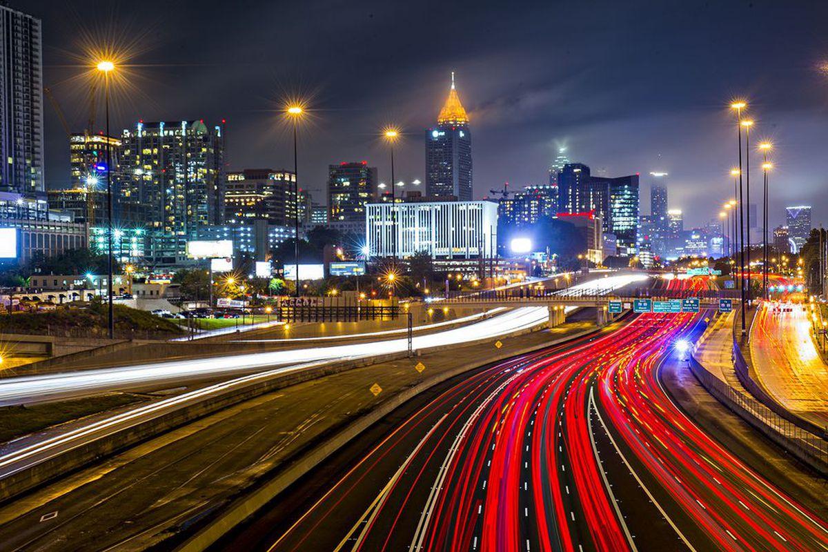 A photo of Midtown and downtown Atlanta at night.