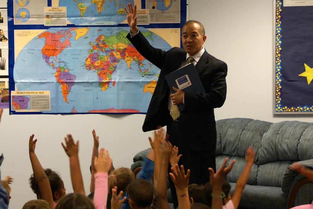 Mike Miles, former superintendent of Harrison schools, visits a classroom in this file photo.