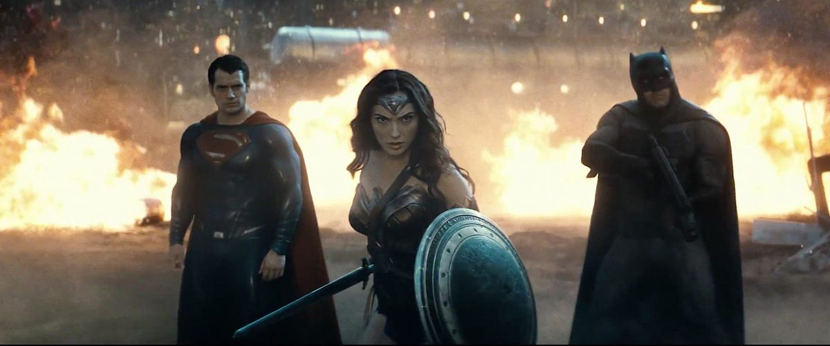 Superman, Wonder Woman, and Batman standing in front of fires together in Batman v. Superman: Dawn of Justice