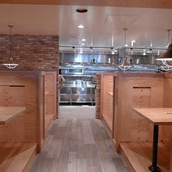 The last two booths will feature a prime view of the semi-open kitchen.