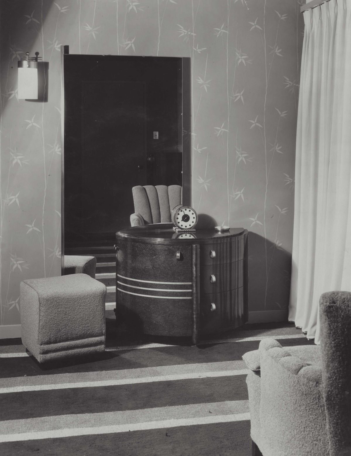 A bedroom with a table, chairs, and wallpaper in Herman Miller's Design for Living House.