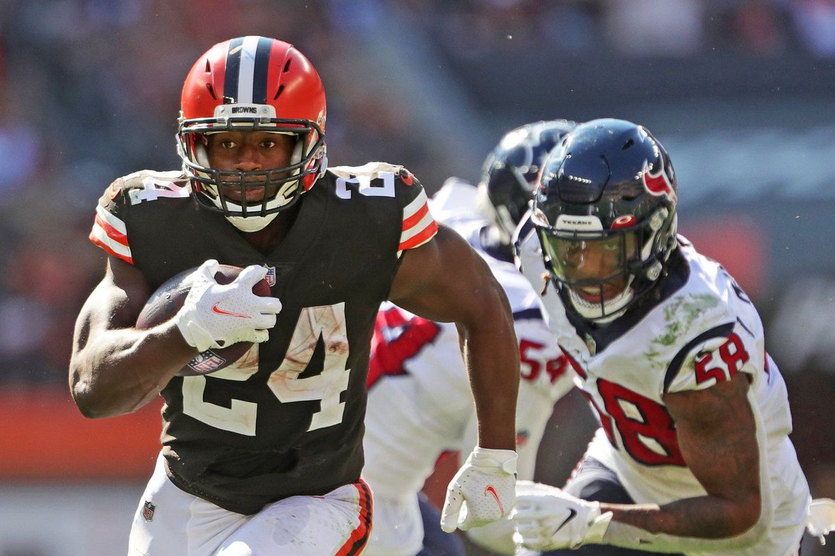 Cleveland Browns running back Nick Chubb (24) rushes for a touchdown ahead of Houston Texans outside linebacker Christian Kirksey (58) during the second half of an NFL football game, Sunday, Sept. 19, 2021, in Cleveland, Ohio.