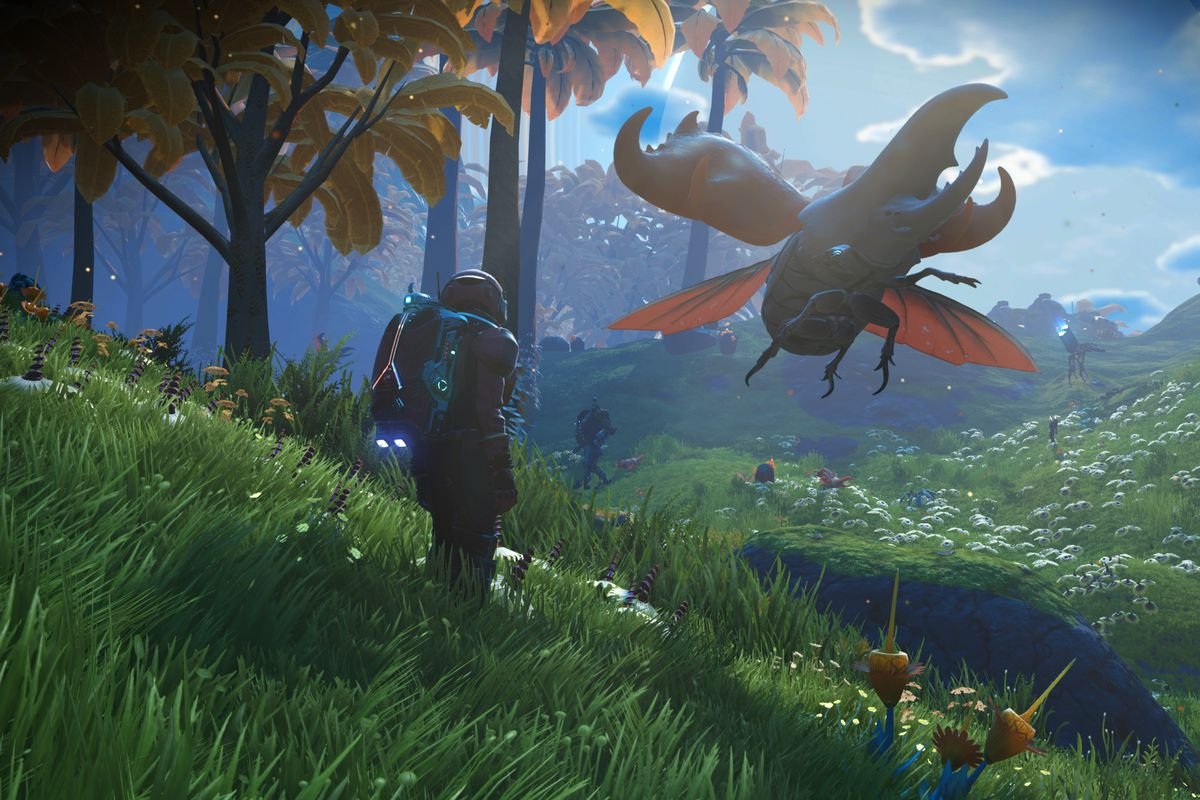 An explorer on a green planet stands near a giant bug in a screenshot from No Man's Sky