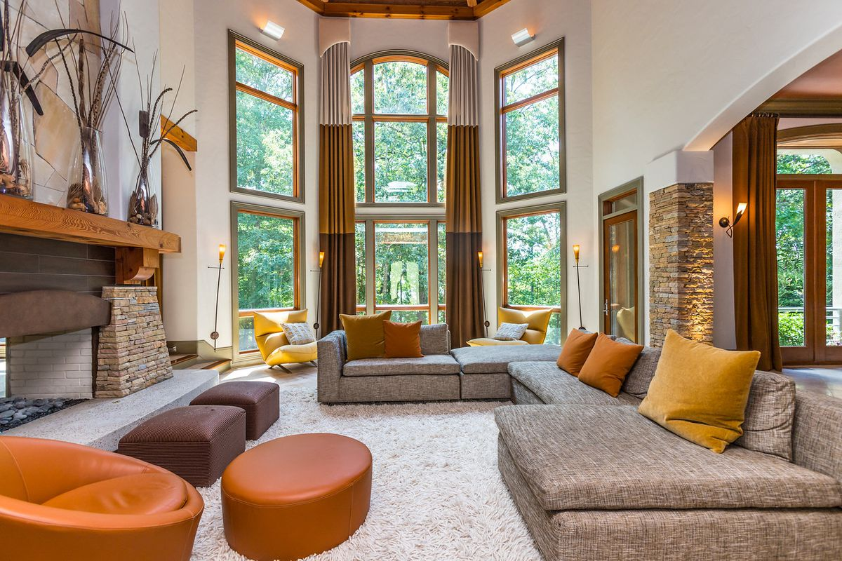 A huge great room with towering windows.