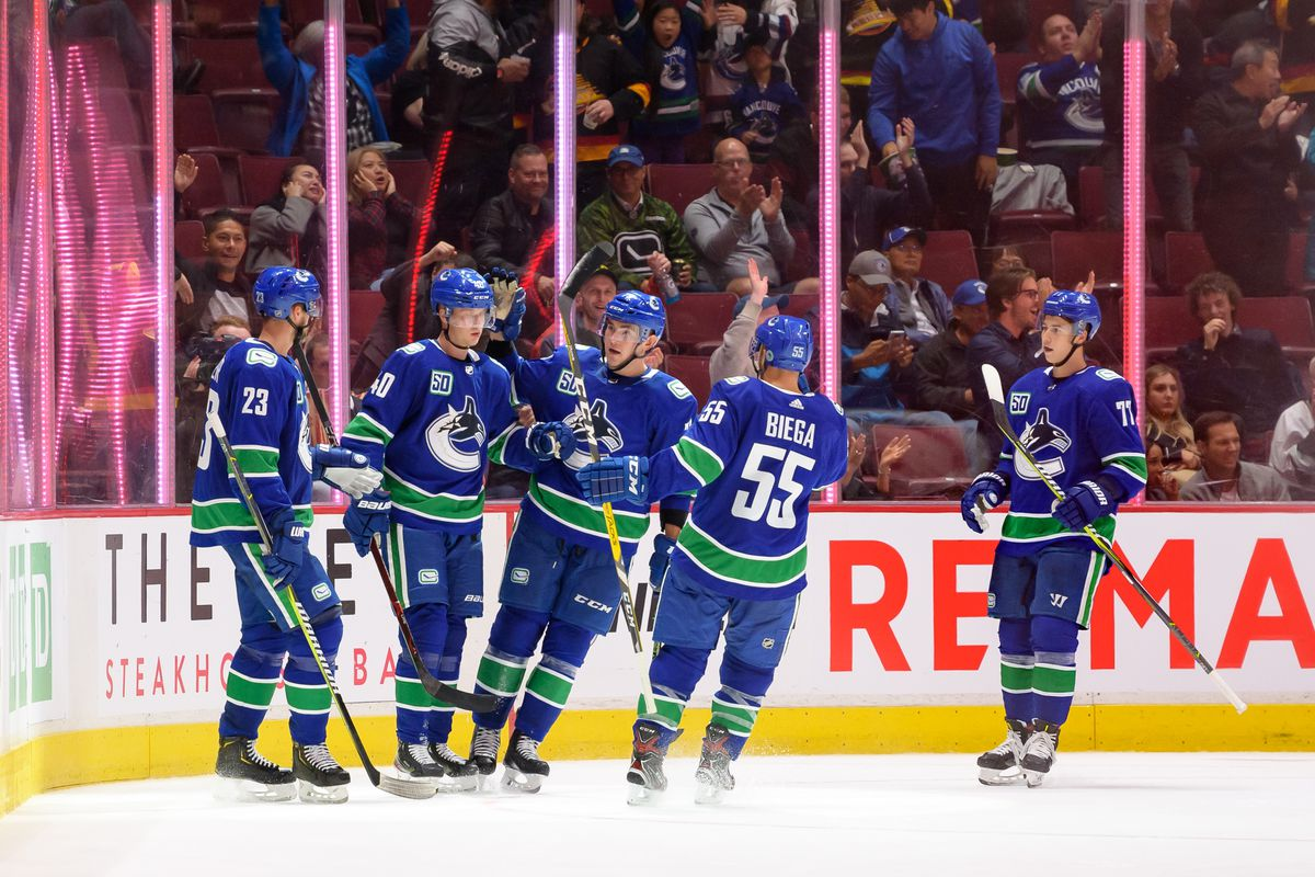Vancouver Canucks Center Elias Pettersson (40) is congratulated after scoring a goal against the Edmonton Oilers during their NHL game at Rogers Arena on September 17, 2019 in Vancouver, British Columbia, Canada. Vancouver won 4-2.