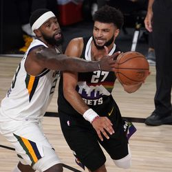 Utah Jazz's Royce O'Neale (23) defends against a pass by Denver Nuggets' Jamal Murray (27) during the second half an NBA first round playoff basketball game, Tuesday, Sept. 1, 2020, in Lake Buena Vista, Fla.