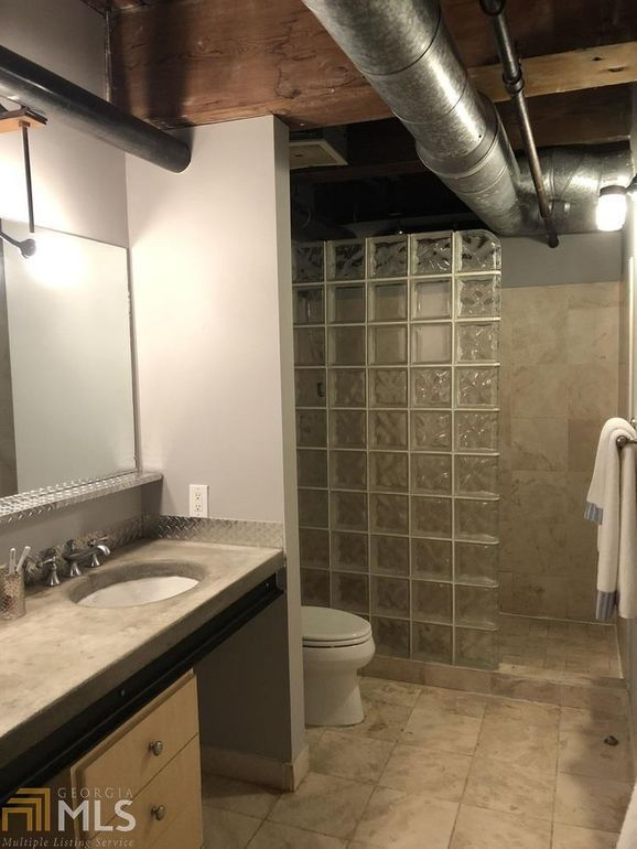 A bathroom with glass block.
