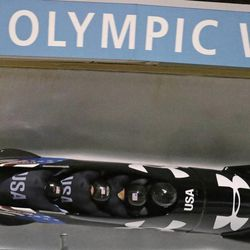From front to back, Steven Holcomb, Curt Tomasevicz, Steve Langton and Chris Fogt race during the United States four-man bobsled team trials on Saturday, Oct. 26, 2013, in Park City, Utah. Holcomb and his crew came in first place.  (AP Photo/Rick Bowmer)