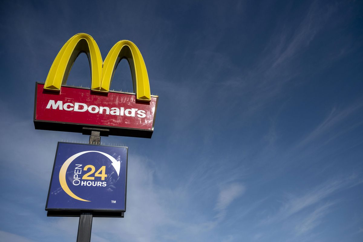 McDonald's UK signage against a blue sky background, as the burger chain considers reopening its restaurants