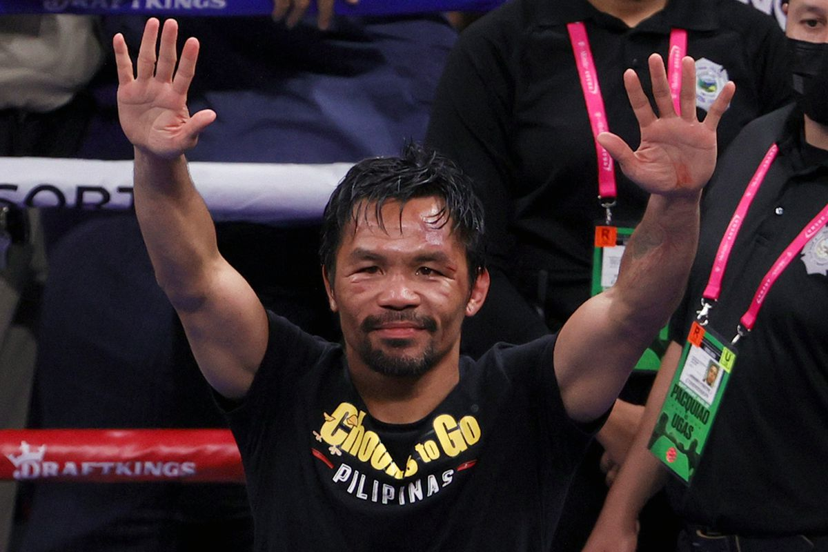 Manny Pacquiao gestures to fans after his WBA welterweight title fight against Yordenis Ugas at T-Mobile Arena on August 21, 2021 in Las Vegas, Nevada.