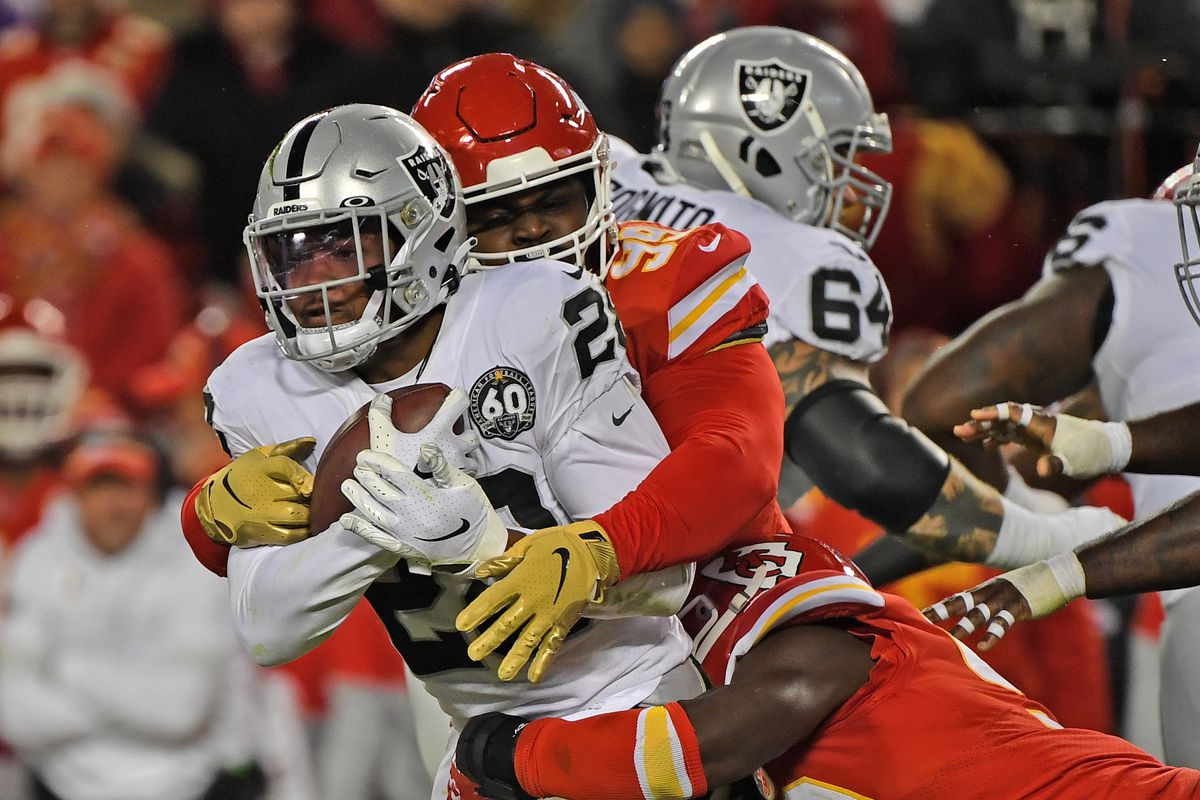 Defensive tackle Khalen Saunders of the Kansas City Chiefs tackles running back Josh Jacobs of the Oakland Raiders against during the second half at Arrowhead Stadium on December 1, 2019 in Kansas City, Missouri.