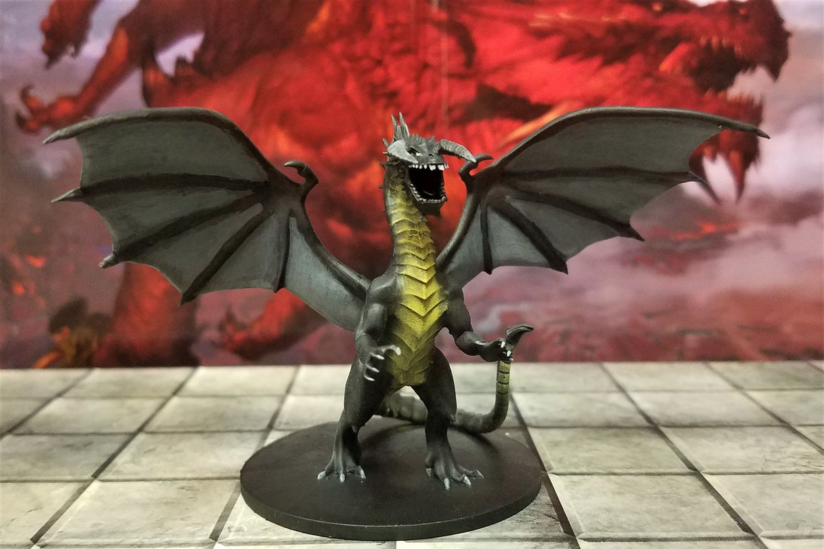 A 3D printed Black dragon showing its golden belly as it rears up. The finish is smooth.