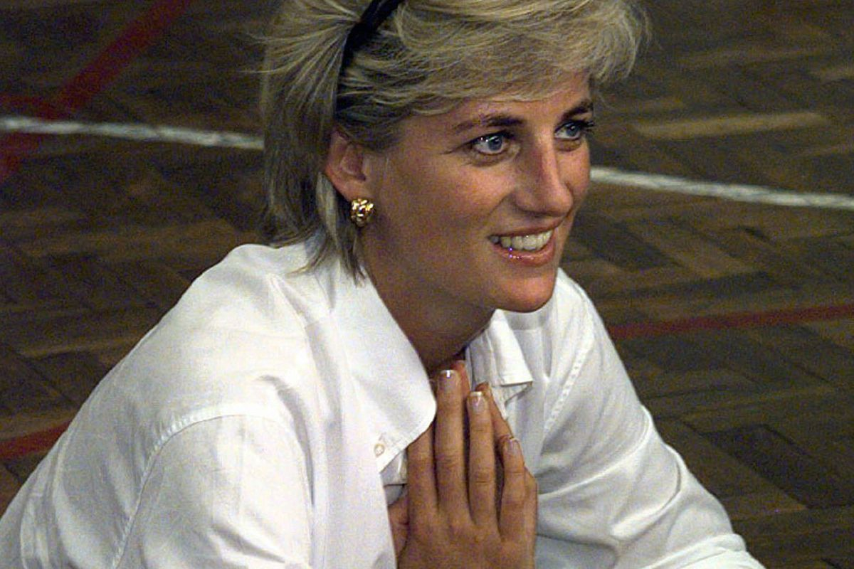 """In this Saturday, Aug. 9, 1997 file photo, Diana, Princess of Wales, sits and talks to members of a Zenica volleyball team who have suffered injuries from mines, during her visit to Zenica, Bosnia. For someone who began her life in the spotlight as """"Shy Di,"""" Princess Diana became an unlikely, revolutionary during her years in the House of Windsor. She helped modernize the monarchy by making it more personal, changing the way the royal family related to people."""