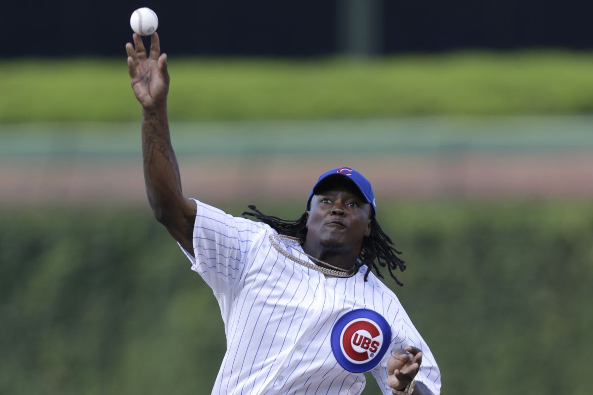 Danny Trevathan throws out the first pitch last summer