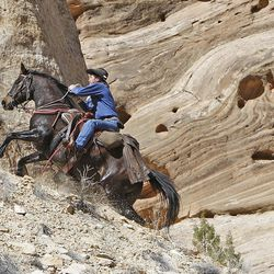 Bobby Lee Thompson rides up an old silver mine tailing while riding horses down the Little Grand Canyon of the San Rafael Swell  Saturday, April 2, 2011, in the San Rafael Swell in Central Utah.