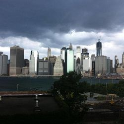 In this photo provided by Gothamist, dark clouds loom over the skyline, Saturday, Sept. 8, 2012, in New York. Two tornadoes struck New York City on Saturday, one swept out of the sea and hit a beachfront neighborhood and the second, stronger twister hit moments later, hurling debris in the air, knocking out power and startling residents who once thought of twisters as a Midwestern phenomenon.