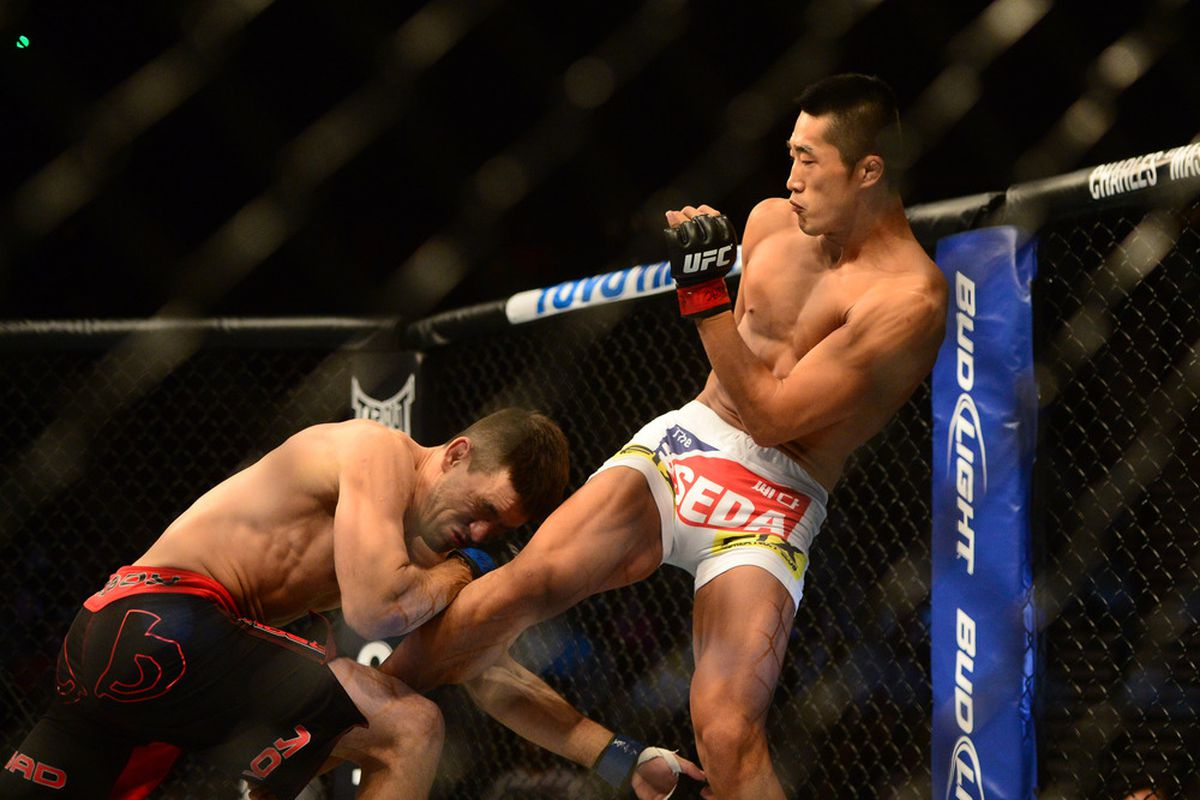 Jul. 7, 2012; Las Vegas, NV, USA; UFC fighter Dong Hyun Kim (right) kicks Demian Maia during a welterweigh bout in UFC 148 at the MGM Grand Garden Arena. Photo: Mark J. Rebilas-US PRESSWIRE