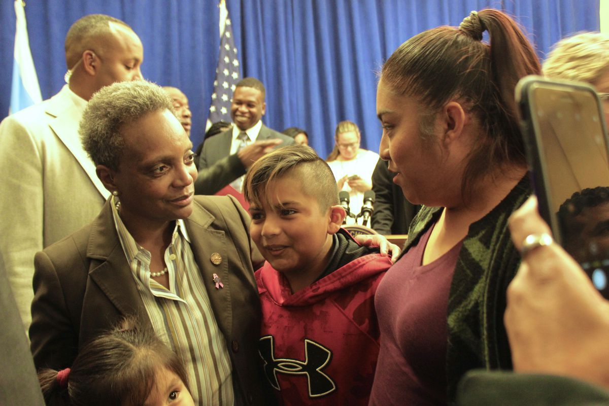 Chicago Mayor Lori Lightfoot spoke with Nury Ortega and her son Alexander Perea-Ortega after a press conference on the eve of Chicago's teachers strike, Oct. 16, 2019.