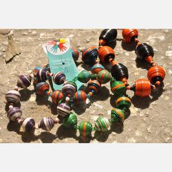 Bold Bracelets - $8.50<br />This Bold Bracelet embodies the sassiness of the women who live in Haiti. Made of a single strand of medium to large beads this bracelet is created in bold colors that accentuate the wrist and hand—and draw attention to whate