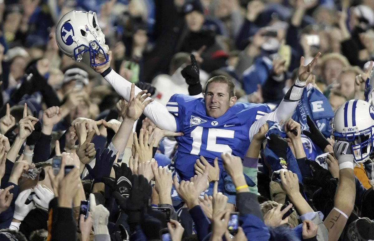 BYU quarterback Max Hall is lifted by fans as they celebrate the victory over Utah 26-23 at LaVell Edwards Stadium. Saturday, Nov. 28, 2009.