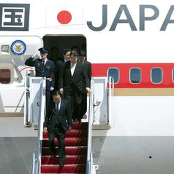Japanese Prime Minister Yoshihiko Noda, bottom, walks down the stairs of his airplane after arriving at Andrews Air Force Base, Md., Sunday, April 29, 2012. President Barack Obama will meet with Noda at the White House, Monday, April 30, 2012.