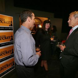 Salt Lake City Mayor Ralph Becker chats with supporters Justin Belliveau and Sarah Lyman while at his election night party at Club 50 West in Salt Lake City on Tuesday, Nov. 3, 2015.