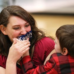 Kamorie Gardiner plays with her son Benjamin as they attend a Town Hall meeting at the Grande Ballroom for Ohio Gov. John Kasich at UVU Friday, March 18, 2016.