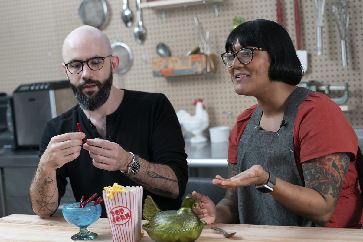 "Andrew Rea, founder of the Binging with Babish network, tastes a beet parsnip licorice created by chef Sohla El-Waylly, during a taping of the ""Stump Sohla"" series in New York."