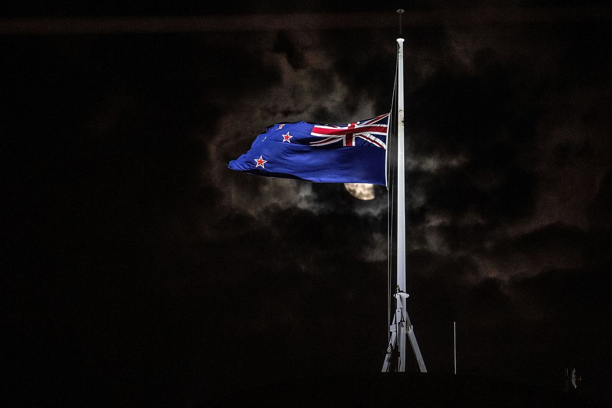 The New Zealand flag is flown at half-mast on a Parliament building following the March 15 mass shootings in Christchurch.