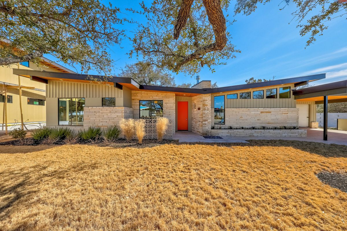 New midcentury modern homes in austin suburb on the for Modern houses for sale austin