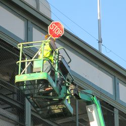 """A better view of the """"stop"""" sign atop Wrigley Field -"""
