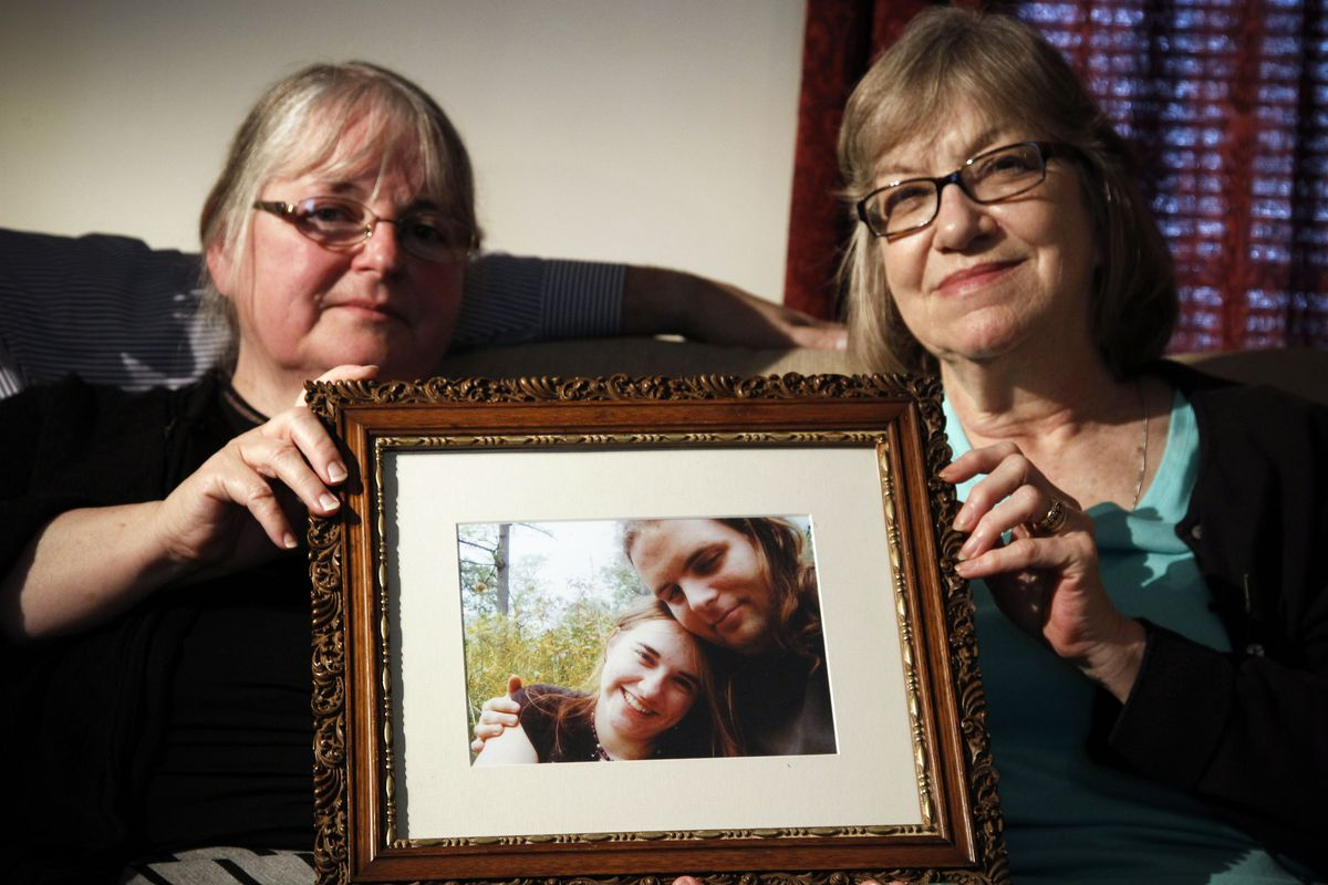 In this June 4, 2014 file photo, mother's Linda Boyle, left and Lyn Coleman hold photo of their married children, Joshua Boyle and Caitlan Coleman, who were kidnapped by the Taliban in late 2012 in Stewartstown, Pa. The State Department is evaluating a v