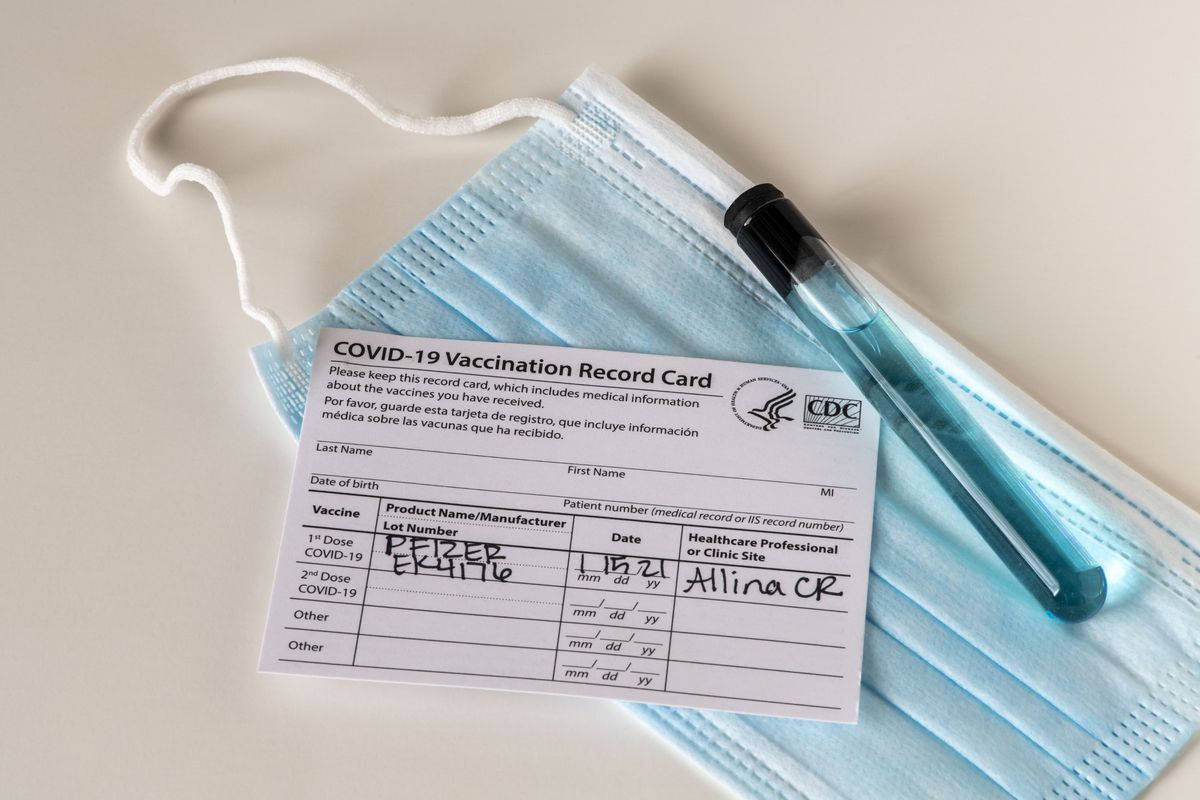 Pfizer Covid-19 vaccination record card with pharmaceutical beaker, Minnesota.