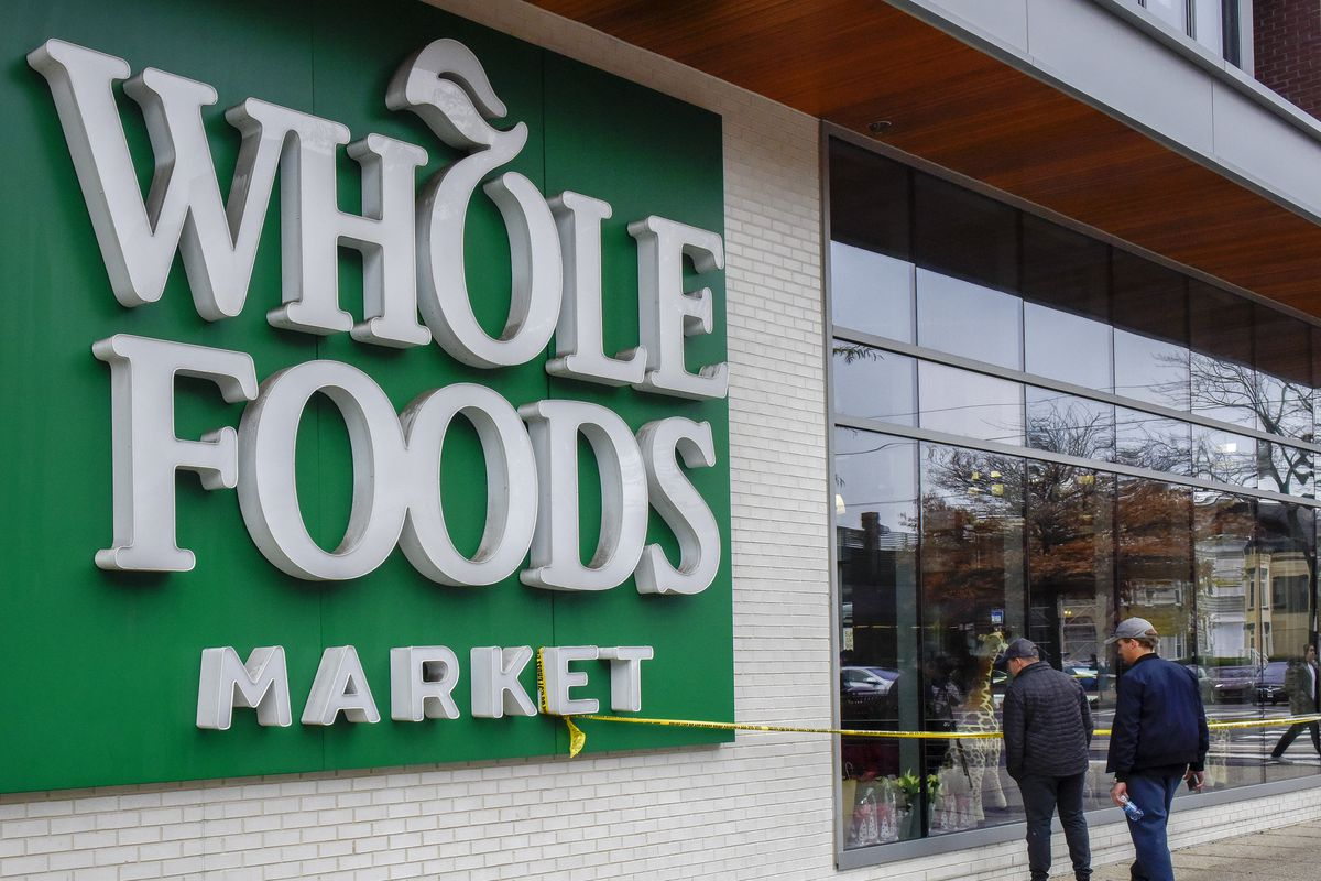 Police investigate a shooting in connection with a robbery attempt at the Whole Foods on H street, NE, in Washington, DC.