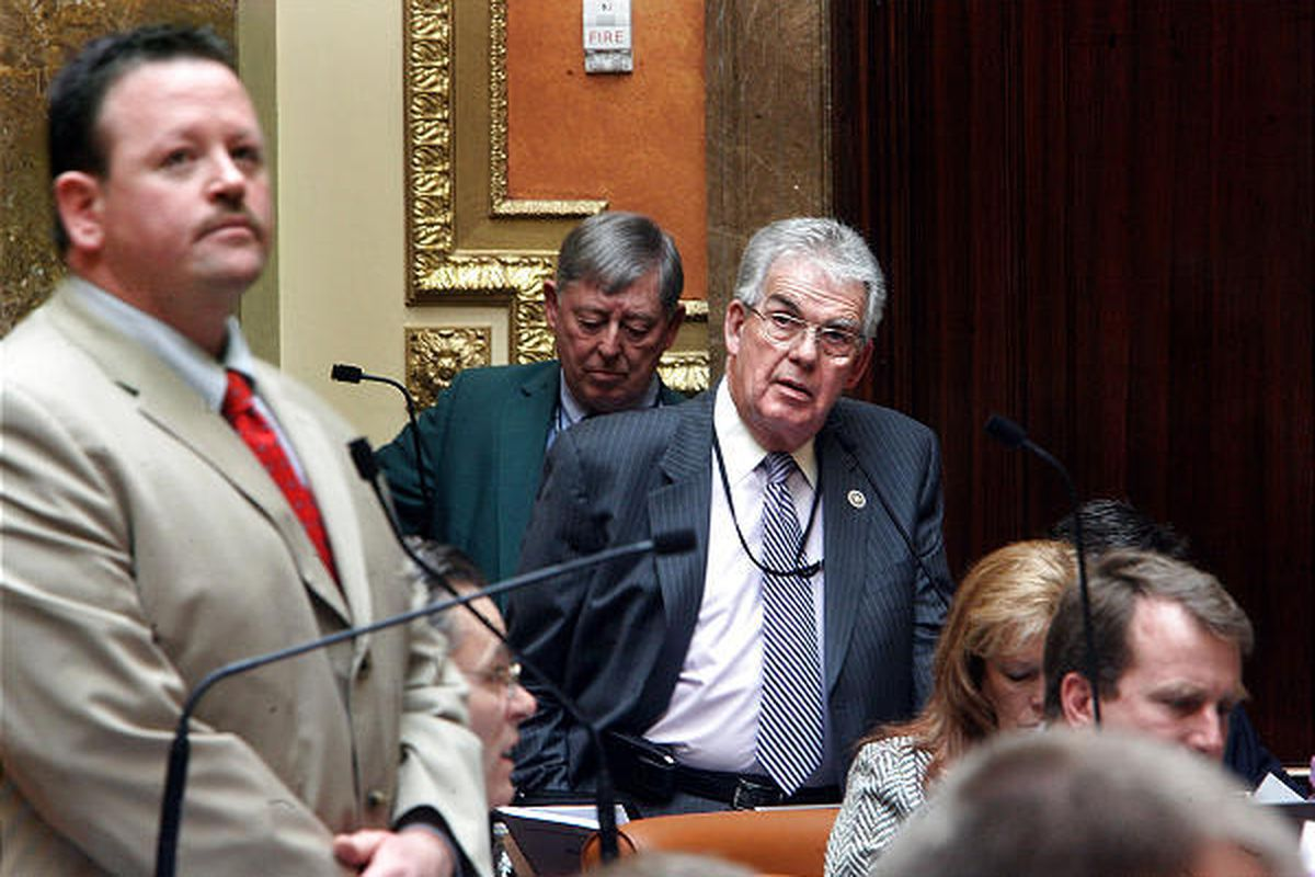 Rep. Carl Wimmer, left, avoids eye contact with Rep. Phil Riesen during debate on HB67over health care reform.