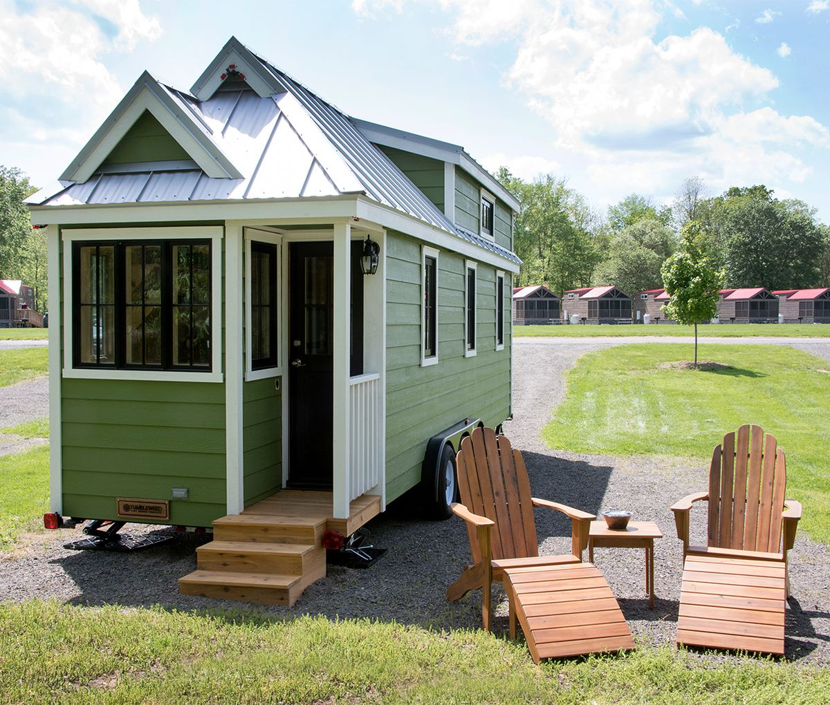 A green and white tiny home.