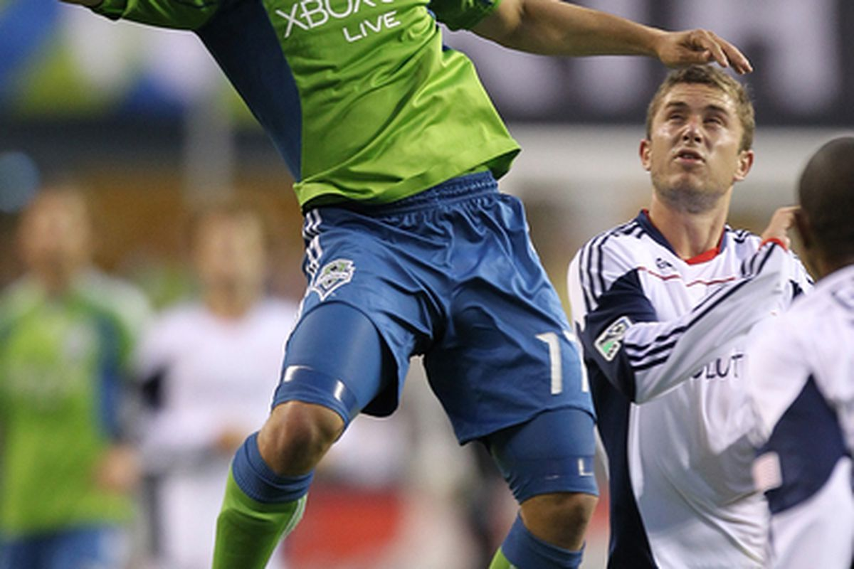 SEATTLE - JUNE 05:  Fredy Montero #17 of the Seattle Sounders FC heads the ball against Chris Tierney #8 of the New England Revolution on June 5, 2010 at Qwest Field in Seattle, Washington. (Photo by Otto Greule Jr/Getty Images)