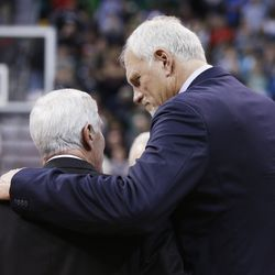 Mark Eaton hugs former Utah Jazz coach Jerry Sloan during his banner unveiled in his honor during halftime of the Utah Jazz game in Salt Lake City Friday, Jan. 31, 2014.