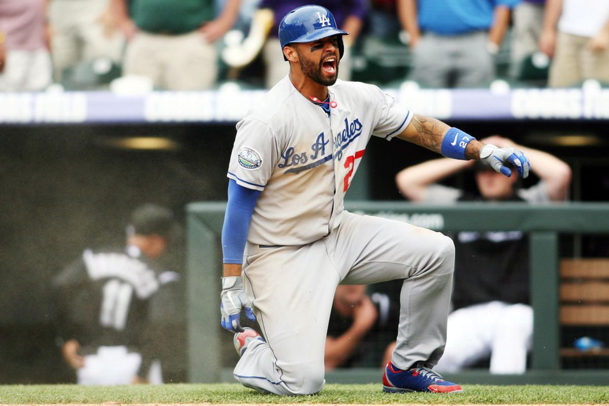 May 2, 2012; Denver, CO, USA; Los Angeles Dodgers center fielder Matt Kemp (27) celebrates after scoring during the ninth inning against the Los Angeles Dodgers at Coors Field.  Mandatory Credit: Chris Humphreys-US PRESSWIRE