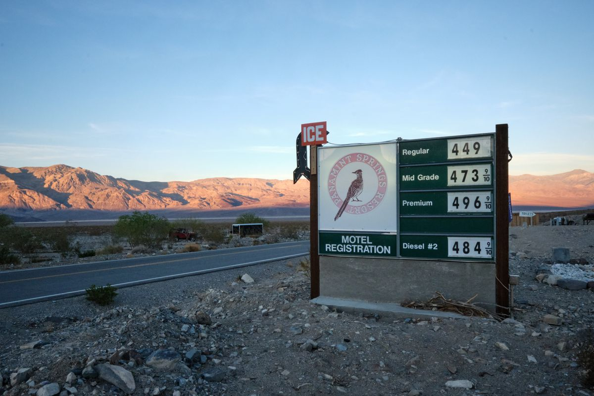 a gas sign in the desert.
