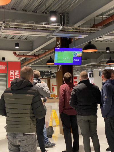Fans in Anfield watch the VAR review process on screens in the concourse on December 29th 2019 following a Liverpool goal — which was subsequently ruled NO HANDBALL. Fans in their seats did not see the images
