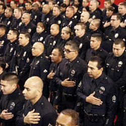 Members of the Los Angeles police and Los Angeles airport police departments stand during the public memorial service for slain TSA officer Gerardo Hernandez, Tuesday, Nov. 12, 2013, in Los Angeles. Hernandez was the first TSA officer killed in the line of duty when a gunman pulled a rifle from a bag and shot the 39-year-old father of two on Nov. 1, at Los Angeles International Airport. Two TSA officers and a teacher were injured before airport police wounded the gunman, Paul Ciancia.