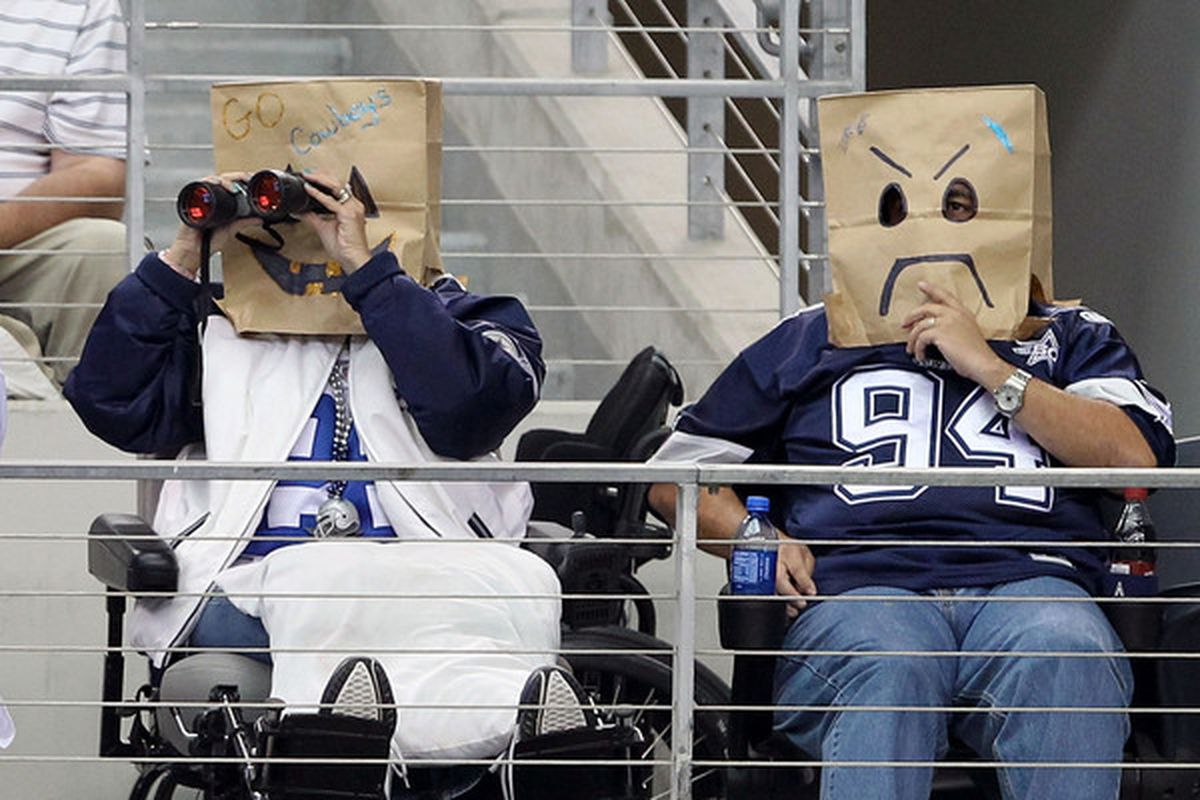 Fans of the Dallas Cowboys wear brown paper bags over their head as they watch the Cowboys play against the Jacksonville Jaguars at Cowboys Stadium on October 31 2010 in Arlington Texas.  (Photo by Chris Chambers/Getty Images)