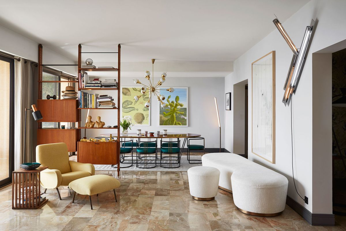 Seafront apartment inspired by grace kelly dazzles in for Modern eclectic interiors