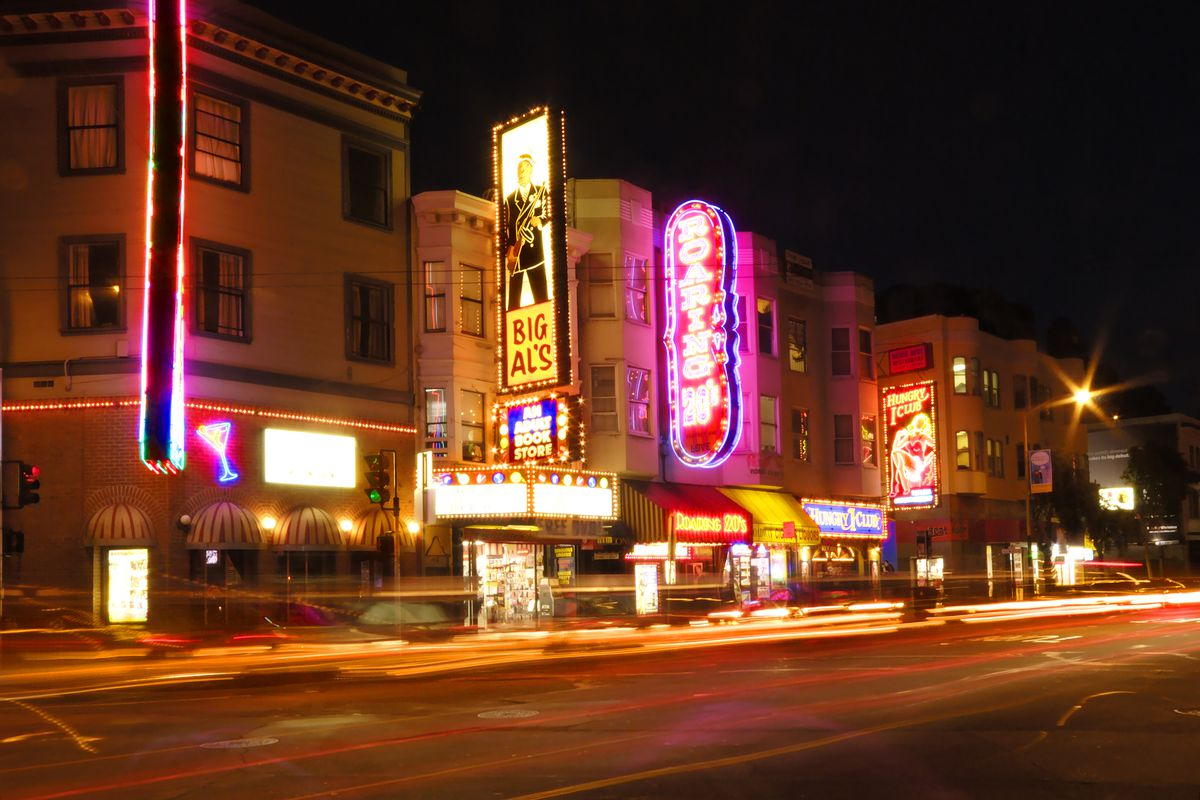A photo of the neon signs of strip clubs in North Beach.