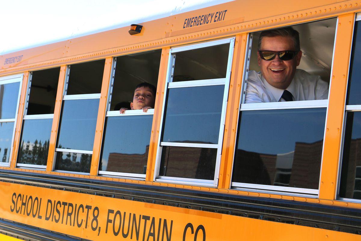 School superintendent Keith Owen looks out a school bus window